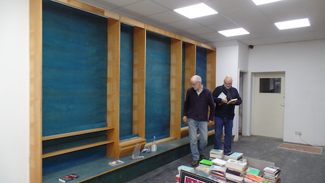 John and Peter contemplate the new shelves